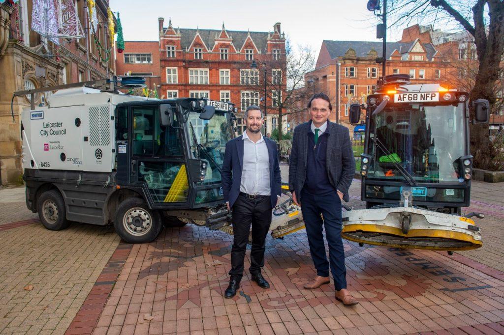 BID Leicester Director Simon Jenner with Deputy City Mayor Adam Clarke and the street washing machines